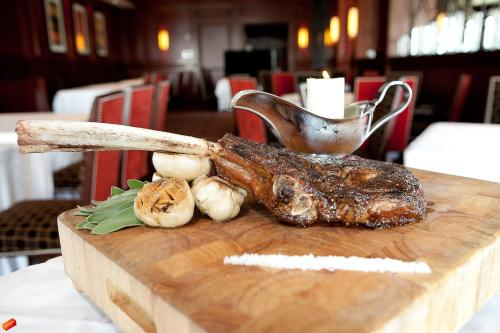 Tomahawk steak presentation at Bull & Bear, inside Waldorf Astoria Orlando