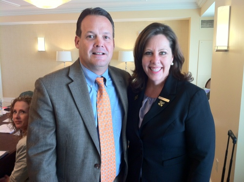 Waldorf Astoria Orlando General Manager John Carns presents Carolyn Moncada with her pins from Les Clefs d'Or, USA.